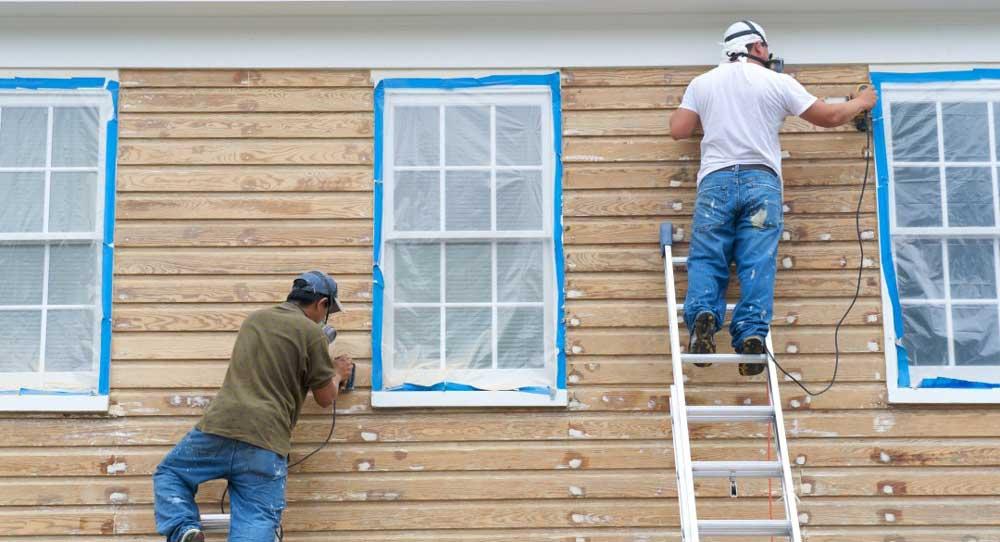 vopsire fatada casa din lemn